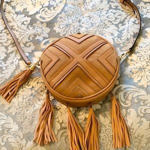 Tan leather and suede crossbody bag with tassels